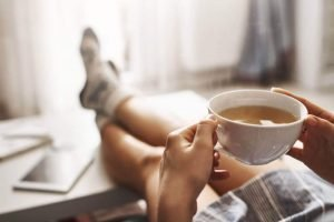 cup-tea-chill-woman-lying-couch